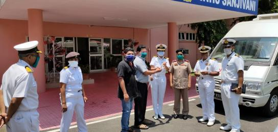NPOL Scientists hands over sanitizer bottles developed by NPOL to the Indian Navy